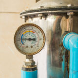 Old pressure gauge. And water pump royalty free stock image