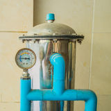 Old pressure gauge. And water pump stock images