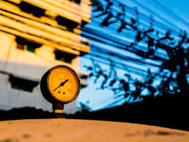The old pressure gauge of watertank at sunset Royalty Free Stock Photo