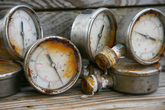 Old pressure gauge on wooden background and empty area for text, damage gauge from operation oil and gas production process Stock Photo