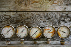 Old pressure gauge on wooden background and empty area for text, damage gauge from operation oil and gas production process Royalty Free Stock Photography