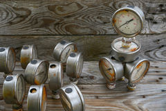 Old pressure gauge on wooden background and empty area for text, damage gauge from operation oil and gas production process Stock Images