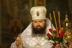 Old priest. Church worker. Man believes in God. Belarus, Gomel city, celebrating the church holiday of Easter in St. Nicholas Monastery 01.05. 2016 year.Unknown Royalty Free Stock Image