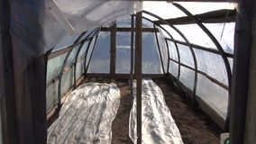 Old primitive greenhouse hothouse in spring after vegetable seeding stock video footage