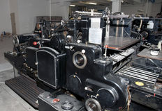Old print finishing machine Stock Photos