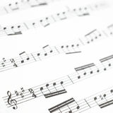 Old printed music sheet or score and musical notes. Old printed music sheet or score photography close up. Musical notes on staves Stock Photography