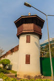 Old prison guard tower that constructed with brick, wood and red. Roof tiles. A watchtower on the corner of a prison wall that named Bangkok Special Prison. Now stock photos