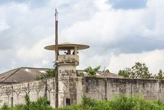 Old prison guard tower or watchtower with security systems barbed wire fence. Around the wall Royalty Free Stock Photos