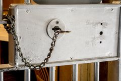 Old Prison Key On A Chain Stuck In A Steel Door Stock Images