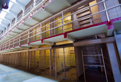Old prison with rows of cells and bars Royalty Free Stock Images