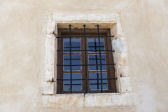 The old prison wall window with iron bars Royalty Free Stock Photos