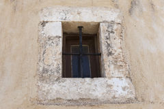 The old prison wall window with iron bars Royalty Free Stock Photography
