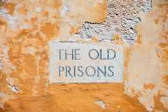 The old prisons sign in the citadel, Gozo. The Old Prisons sign embedded in a building wall within the citadel, Victoria Rabat, Gozo, Malta, Europe Royalty Free Stock Photography