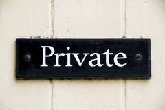 Old private sign screwed to a door Royalty Free Stock Photos