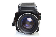 Old professional medium format camera. Front view - Retro medium format SLR camera from the seventies on white background royalty free stock photos