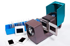 Old projector for displaying of slides. Slides in blue box on wh Royalty Free Stock Image