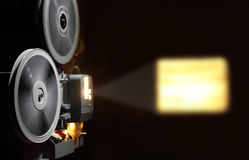 Old projector showing film. Old projector showing the film in dusk Royalty Free Stock Photos