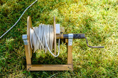 Old prolongation electric cable on green grass in the park Stock Image