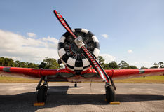 Old propeller airplane. Retro propeller airplane painted red front view Royalty Free Stock Photo