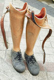Old prosthetic legs set on a cement floor Royalty Free Stock Photos