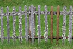 Old provincial retro fence with unusual elements royalty free stock photos