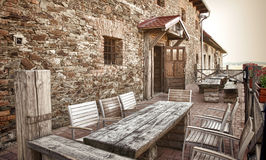 Old pub. Old stone pub with wooden benches Royalty Free Stock Photo