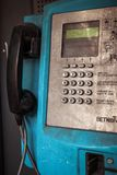 Old public blue payphone closeup, urban mood, dirty rusty buttons Stock Photo