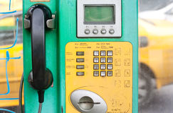 Old public coin-operated telephone Stock Images