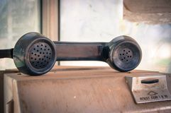 Old public coin-operated telephone Royalty Free Stock Image