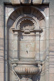 Old public drinking fountain carved in stone Royalty Free Stock Photos
