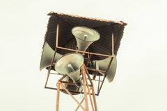 Old public loudspeakers broadcast on high tower. With long distance tower Stock Photography
