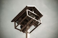 Old public loudspeakers broadcast on high tower. With long distance tower Royalty Free Stock Photography