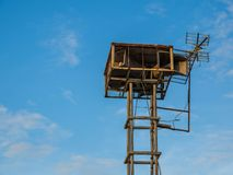 Old public loudspeakers broadcast vintage style on high tower the blue sky background.  Stock Image