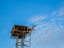 Old public loudspeakers broadcast vintage style on high tower the blue sky background.  Royalty Free Stock Photos
