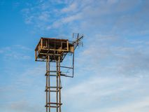 Old public loudspeakers broadcast vintage style on high tower the blue sky background.  Royalty Free Stock Photo
