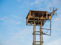 Old public loudspeakers broadcast vintage style on high tower the blue sky background.  Royalty Free Stock Image