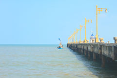 Old public pier and light pole Royalty Free Stock Photo
