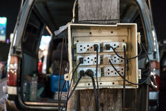 Old public plug socket at outdoor night market Royalty Free Stock Photography