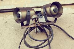 Old Public Speakers. A pair of old loudspeakers at a railway station Stock Images