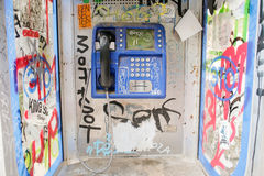 Old public telephone booth. Telephone booth with graffiti in Athens in beautiful colors stock images
