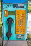 Old public telephone coin Stock Photography