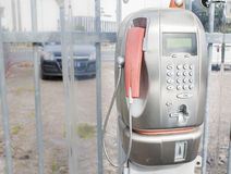 Old public telephone coin (Payphone) Stock Images