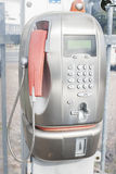 Old public telephone coin (Payphone). Old public payphone, no longer in operation stock photography