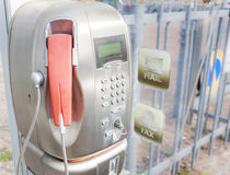 Old public telephone coin (Payphone). Old public payphone, no longer in operation stock images