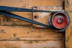 Old pulley in an old agricultural machine. Threshing machine, pu Royalty Free Stock Photography