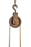 Old pulley with rope Royalty Free Stock Image