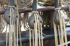 Old pulleys and ropes, marine tools. Old pulleys and ropes on an old wooden sailing ship royalty free stock photography