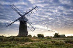 Old pump windmill in English countryside landscape early morning Royalty Free Stock Photo