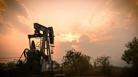Old pumpjack pumping crude oil from oil well stock video