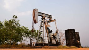 Old pumpjack pumping crude oil from oil well stock footage